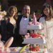 Stock Photo: Hispanic girl cutting cake at Quinceanera