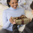 African woman receiving gift from mother — Stock Photo