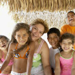 Hispanic family laughing - Stock Photo