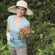 Hispanic woman gardening — Stock Photo