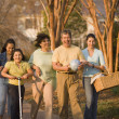 Hispanic family walking in park — Stock Photo