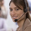 Indian businesswoman wearing headset — Stock Photo