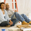 African couple taking lunch break from painting — Stock Photo #23278100