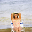 Asian woman sitting in beach chair — Stock Photo