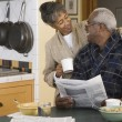 Senior African couple at breakfast table — Stock Photo