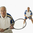 Senior men playing tennis — Stockfoto