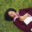 African businesswoman laying in grass — 图库照片