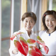 Asian mother and adult daughter arranging flowers — Stock Photo