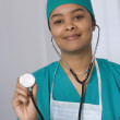 Stock Photo: Africfemale doctor holding up stethoscope