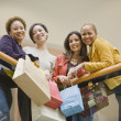 Multi-ethnic women with shopping bags — Stock Photo