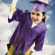 Stock Photo: Africgirl wearing graduation cap and gown