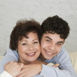 Hispanic grandmother and grandson hugging — Stock Photo