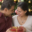 Stock Photo: Hispanic couple exchanging gift