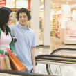 Multi-ethnic teenage couple in mall — Stock Photo