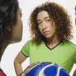 Multi-ethnic women holding soccer ball — ストック写真