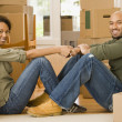 African couple in new house — Stock Photo