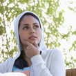 Young woman wearing hooded sweatshirt — Stock Photo