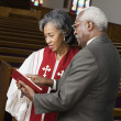 African American female Reverend talking to parishioner — Stock Photo