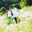 African couple walking in park — Stock Photo #23279288