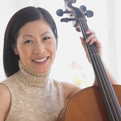 Close up of Middle-aged Asian woman with cello — Stock Photo