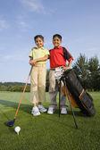 Hispano hermano y hermana en golf — Foto de Stock