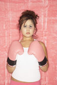 Pacific Islander woman wearing boxing gloves — Stockfoto