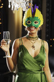 Portrait of Hispanic woman at masquerade party — Foto Stock