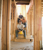 Portrait of male construction workers in construction site — Stock Photo