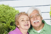 Senior Hispanic couple hugging outdoors — Stock Photo