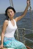 Portrait of Asian woman on sailboat — Stock Photo