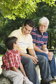 """Hispanic grandfather, father and son sitting together"" — Stock Photo"