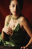 Portrait of Hispanic woman holding cocktail — Stock Photo