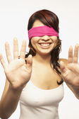 Blindfolded Asian woman holding hands up — Stock Photo