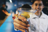 Pacific Islander man toasting with cocktail at bar — Stock Photo