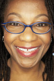 Close up of middle-aged African woman wearing eyeglasses — Stock Photo