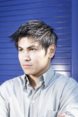 Close up of Asian man looking serious — Stock Photo