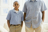 Portrait of African boy next to father — Stock Photo