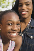 Close up of African girl with mother — Stock Photo