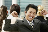 Young Asian businessman cheering — Stock Photo