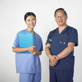 Portrait of Asian male and female doctors — Stock Photo