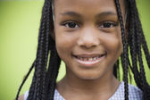 Close up of African girl smiling — Stock Photo