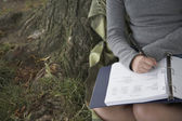 Close up of girl studying with notebook outdoors — Stock Photo