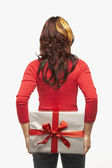 Asian woman holding gift behind back — Stock Photo