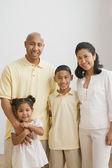 Portrait of multi-ethnic family hugging — Stock Photo