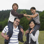 Multi-ethnic family playing at park — Stock Photo