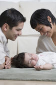 Hispanic parents smiling at baby — Stock Photo