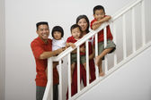Portrait of Asian family on stairs — 图库照片