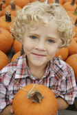 Portrait of boy holding pumpkin — Stock Photo