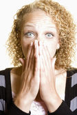 Woman covering her mouth in surprise — Foto de Stock