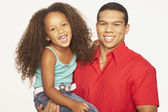 Portrait of African father holding daughter — Stock Photo